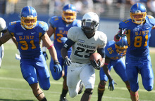 Utah State running back Kerwynn Williams (25) runs for a touchdown chased by San Jose State's Keith Smith (31) and San Jose State  James Orth (81) in the second quarter of an NCAA college football game in San Jose, Calif., Saturday, Oct. 13, 2012. (AP Photo/Darryl Bush)
