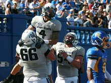 Utah State wide receiver Matt Austin (4) celebrates his touchdown with teammates Eric Schultz (66) and Jamie Markosian (54) in the first quarter of an NCAA college football game against San Jose  State in San Jose, Calif., Saturday, Oct. 13, 2012. (AP Photo/Darryl Bush)
