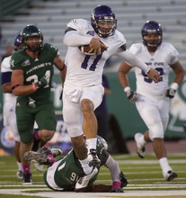 Weber State quarterback Mike Hoke (11) slips a tackle by a Sacramento State player during an NCAA college football game Saturday, Oct. 13, 2012, in Sacramento, Calif. (AP Photo/The Sacramento Bee, Randall Benton) MAGS OUT; TV OUT (KCRA3, KXTV10, KOVR13, KUVS19, KMAZ31, KTXL40) MANDATORY CREDIT