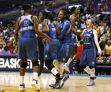 The Minnesota Lynx players celebrate their team's 80-79 win after Game 2 of the WNBA basketball Western Conference Finals against the Los Angeles Sparks in Los Angeles, Sunday, Oct. 7, 2012. (AP Photo/Jae C. Hong)