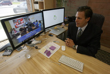 Francisco Kjolseth  |  The Salt Lake Tribune Chet Linton, CEO and president of the Midvale company School Improvement Network, looks over one of its 3,000 or so videos, this one from a classroom in Kentucky.