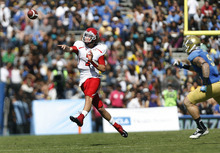 Scott Sommerdorf  |  The Salt Lake Tribune              Utah Utes quarterback Travis Wilson (7) throws to WR Dres Anderson during first half play. UCLA led Utah 14-7 at the half. Utah plays UCLA in Pasadena, Saturday, October 13, 2012.