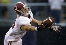 Alabama defensive back Vinnie Sunseri intercepts a pass during the first quarter of an NCAA college football game against Missouri Saturday, Oct. 13, 2012, in Columbia, Mo. (AP Photo/Jeff Roberson)