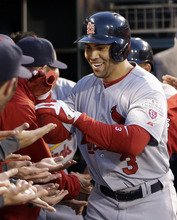 St. Louis Cardinals' Carlos Beltran (3) is congratulated in the dugout after hitting a two-run home run during the fourth inning of Game 1 of baseball's National League championship series against the San Francisco Giants Sunday, Oct. 14, 2012, in San Francisco. (AP Photo/David J. Phillip)