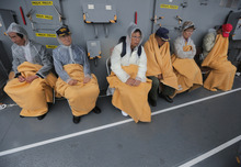 Visitors take a rest at the Japanese Maritime Self-Defense Force (JMSDF) destroyer