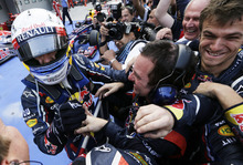 Red Bull driver Sebastian Vettel of Germany  celebrates with his team after his win in the Korean Formula One Grand Prix at the Korean International Circuit in Yeongam, South Korea, Sunday, Oct. 14, 2012. (AP Photo/Lee Jin-man)