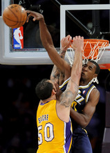 Los Angeles Lakers center Robert Sacre (50) and Utah Jazz forward Jeremy Evans, right, collide at the basket during the first half of an NBA preseason basketball game, Saturday, Oct. 13, 2012, in Los Angeles. (AP Photo/Gus Ruelas)