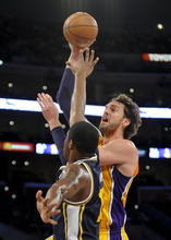 Los Angeles Lakers forward Pau Gasol (16), of Spain, gets over Utah Jazz forward Derrick Favors (15) for a basket during the first half of an NBA preseason basketball game, Saturday, Oct. 13, 2012, in Los Angeles. (AP Photo/Gus Ruelas)
