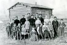 Mrs. Liddia Tevvs Winters school children at the Coyote school in Coyote, Utah, 1885. Coyote was located near Bryce Canyon. The name of the city changed first to Grass Valley then to Antimony in 1921 when deposits of the antimony ore stibnite were found in Coyote Canyon, and a mining industry began. Courtesy Utah State Historical Society