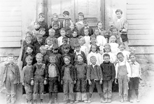 First grade students from Mammoth, Utah pose outside the classroom with their teacher. Circa 1906. Courtesy Utah State Historical Society