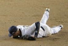 New York Yankees shortstop Derek Jeter lays on the infield after injuring himself in the 12th inning of Game 1 of the American League championship series against the Detroit Tigers Sunday, Oct. 14, 2012, in New York.(AP Photo/Charlie Riedel)