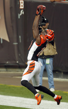Cincinnati Bengals wide receiver A.J. Green catches a 5-yard touchdown pass in the second quarter of an NFL football game against the Cleveland Browns, Sunday, Oct. 14, 2012, in Cleveland. (AP Photo/Tony Dejak)
