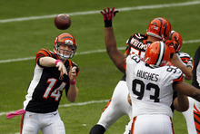 Cincinnati Bengals quarterback Andy Dalton (14) passes against the Cleveland Browns in the second quarter of an NFL football game Sunday, Oct. 14, 2012, in Cleveland. (AP Photo/Tony Dejak)