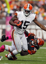 Cincinnati Bengals cornerback Adam Jones (24) tries to tackle Cleveland Browns wide receiver Greg Little in the third quarter of an NFL football game Sunday, Oct. 14, 2012, in Cleveland. (AP Photo/Scott R. Galvin)
