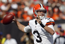 Cleveland Browns quarterback Brandon Weeden passes against the Cincinnati Bengals in the first quarter of an NFL football game Sunday, Oct. 14, 2012, in Cleveland. (AP Photo/Scott R. Galvin)