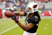 Arizona Cardinals wide receiver Larry Fitzgerald (11) warms up prior to an NFL football game against the Buffalo Bills, Sunday, Oct. 14, 2012, in Glendale, Ariz.  (AP Photo/Matt York)