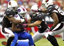 Buffalo Bills wide receiver Brad Smith (16) is stopped by Arizona Cardinals Daryl Washington (58), Jamell Fleming (23) and O'Brien Schofield (50) during the first half on an NFL football game, Sunday, Oct. 14, 2012, in Glendale, Ariz.  (AP Photo/Matt York)