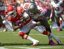 Kansas City Chiefs wide receiver Dexter McCluster (22) is tackled by Tampa Bay Buccaneers defensive tackle Daniel Te'o-Nesheim (50) after a reception during the first half of an NFL football game on Sunday, Oct. 14, 2012, in Tampa, Fla. (AP Photo/Phelan M. Ebenhack)