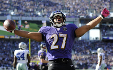 Baltimore Ravens running back Ray Rice reacts after scoring a touchdown in the second half of an NFL football game against the Dallas Cowboys in Baltimore, Sunday, Oct. 14, 2012. (AP Photo/Nick Wass)