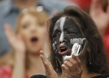 A Raiders fan cheers during the first half of an NFL football game against the Oakland Raiders, Sunday, Oct. 14, 2012, in Atlanta. (AP Photo/John Bazemore)