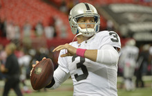 Oakland Raiders quarterback Carson Palmer (3) works before the first half of an NFL football game against the Atlanta Falcons, Sunday, Oct. 14, 2012, in Atlanta. (AP Photo/Rich Addicks)