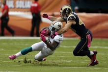 St. Louis Rams strong safety Craig Dahl (43) tackles Miami Dolphins wide receiver Davone Bess (15)  during the first half of an NFL football game Sunday, Oct. 14, 2012 in Miami . (AP Photo/Lynne Sladky)