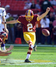Washington Redskins kicker Kai Forbath kicks during warm ups before an NFL football game Minnesota Vikings Sunday, Oct. 14, 2012, in Landover, Md. (AP Photo/Richard Lipski)