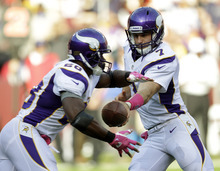 Minnesota Vikings quarterback Christian Ponder hands off the ball to Minnesota Vikings running back Adrian Peterson during the first half of an NFL football game against the Washington Redskins Sunday, Oct. 14, 2012, in Landover, Md. (AP Photo/Pablo Martinez Monsivais)