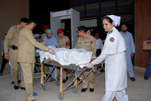 In this photo released by Inter Services Public Relations Department, Pakistani army doctors and medical staff transport 14-year-old schoolgirl Malala Yousufzai, who was shot last Tuesday by the Taliban, to transfer her from a military hospital to the airport in Rawalpindi, Pakistan, Monday, Oct. 15, 2012. Pakistan airlifted Yousufzai to the United Kingdom for treatment Monday, a move that will give her access to the specialized medical care she needs to recover and also protect her from follow-up attacks threatened by the militants. (AP Photo/Inter Services Public Relations Department)