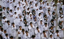 Pakistani schoolgirls pray for the recovery of 14-year-old schoolgirl Malala Yousufzai, who was shot last Tuesday by the Taliban for speaking out in support of education for women, at their school yard in Gujranwala, Pakistan, Monday, Oct. 15, 2012. Pakistan airlifted a 14-year-old activist who was shot and seriously wounded by the Taliban to the United Kingdom for treatment Monday, a move that will give her access to the specialized medical care she needs to recover and also protect her from follow-up attacks threatened by the militants. (AP Photo/Aftab Rizvi)