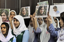 Kamran Jebreili  |  The Associated Press Pakistani students sing as they hold pictures of 14-year-old schoolgirl Malala Yousufzai, who was shot last Tuesday by the Taliban for speaking out in support of education for women, during a tribute at the Pakistani Embassy in Abu Dhabi, United Arab Emirates. Pakistan airlifted a 14-year-old activist who was shot and seriously wounded by the Taliban to the United Kingdom for treatment Monday, a move that will give her access to the specialized medical care she needs to recover and also protect her from follow-up attacks threatened by the militants.