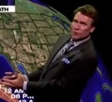 Video screen capture  Weatherman Dan Pope explains the path of Tropical Storm John during a broadcast.