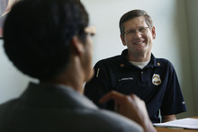 Scott Sommerdorf  |  The Salt Lake Tribune              SLCPD Sgt. Dan Brewster speaks with Asha Parekh at the YWCA center at 310 E. 300 South in Salt Lake City. The YWCA announced a new $900K grant to help pay for more police and prosecutor time to combat domestic violence, Monday, October 15, 2012.