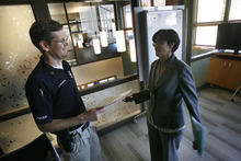 Scott Sommerdorf  |  The Salt Lake Tribune              SLCPD Sgt. Dan Brewster speaks with Asha Parekh in one of the main counseling rooms at the YWCA center at 310 E. 300 South in Salt Lake City. The YWCA announced a new $900K grant to help pay for more police and prosecutor time to combat domestic violence, Monday, October 15, 2012.