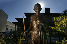 Scott Sommerdorf  |  The Salt Lake Tribune              A statue of Mahatma Ghandi stands outside the YWCA center at 310 E. 300 South in Salt Lake City. The YWCA announced a new $900K grant to help pay for more police and prosecutor time to combat domestic violence, Monday, October 15, 2012.