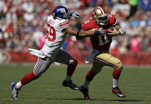 New York Giants outside linebacker Michael Boley (59) tackles San Francisco 49ers quarterback Alex Smith (11) during the first quarter of an NFL football game in San Francisco, Sunday, Oct. 14, 2012. (AP Photo/Marcio Jose Sanchez)