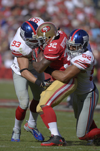 New York Giants middle linebacker Chase Blackburn (93) and linebacker Spencer Paysinger (52) tackle San Francisco 49ers running back Kendall Hunter (32) during the second half of an NFL football game in San Francisco, Sunday, Oct. 14, 2012. (AP Photo/Mark J. Terrill)