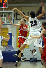 Steve Griffin  |  The Salt Lake Tribune  Syracuse's Brittney Martin, right, blocks the path of American Fork's Ashley Baugh during 5A semifinal girl's basketball game between Syracuse and American Fork at the Salt Lake Community College in West Valley City, Utah  Friday, February 24, 2012.
