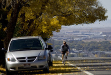 Kim Raff  |  The Salt Lake Tribune A bike rider travels on east Sunnyside Avenue in Salt Lake City on Sunday, October 14, 2012. In January, Mayor Ralph Becker, as part of his
