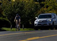 Kim Raff  |  The Salt Lake Tribune A bike rider travels east on Sunnyside Avenue in Salt Lake City on Sunday, October 14, 2012. In January, Mayor Ralph Becker, as part of his