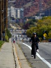 Kim Raff  |  The Salt Lake Tribune A bike rider travels on Sunnyside Avenue toward Guardsman Way in Salt Lake City on Sunday, October 14, 2012. In January, Mayor Ralph Becker, as part of his