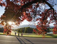 Al Hartmann  |  The Salt Lake Tribune Long shadows follow runners in Sugarhouse Park in Salt Lake City as the sun rises above the peaks of the Wasatch Mountains on Monday, Oct. 15. Autumn colors have begun to make their appearance in the Salt Lake Valley.