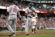 St. Louis Cardinals' Pete Kozma (38) is greeted by John Jay (19) after scoring on a double by Chris Carpenter against the San Francisco Giants during the second inning of Game 2 of baseball's National League championship series, Monday, Oct. 15, 2012, in San Francisco. (AP Photo/The Sacramento Bee, Paul Kitagaki Jr.)  MAGS OUT; LOCAL TV OUT (KCRA3, KXTV10, KOVR13, KUVS19, KMAZ31, KTXL40); MANDATORY CREDIT