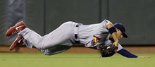 St. Louis Cardinals' Jon Jay makes a diving catch on a ball hit by San Francisco Giants' Brandon Crawford during the eighth inning of Game 2 of baseball's National League championship series Monday, Oct. 15, 2012, in San Francisco. (AP Photo/David J. Phillip)