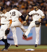San Francisco Giants' Angel Pagan and Pablo Sandoval (48) celebrate after Game 2 of baseball's National League championship series against the St. Louis Cardinals Monday, Oct. 15, 2012, in San Francisco. The Giants won 7-1 to ties the series 1-1. (AP Photo/David J. Phillip)