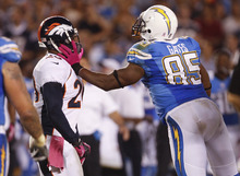 San Diego Chargers tight end Antonio Gates, right, pushes Denver Broncos strong safety Mike Adams during the first half of an NFL football game Monday, Oct. 15, 2012, in San Diego. (AP Photo/Lenny Ignelzi )