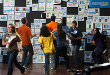 Trent Nelson  |  The Salt Lake Tribune Contestants race to pull coupons with the most value from a wall during one of the budgeting challenges filmed Tuesday at the Murray Theater for the second season of Zions Bank's