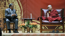 His Holiness the 14th Dalai Lama, right, listens to Andrew Young during a symposium on The Rise of Democracy in the Middle East as part of the Common Ground for Peace two-day forum in Syracuse, N.Y., Monday, Oct. 8, 2012. (AP Photo/Kevin Rivoli)