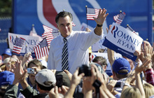 Republican presidential candidate, former Gov. Mitt Romney waves to the crowd as he arrives for a rally in Richmond, Va., Friday, Oct. 12, 2012.(AP Photo/Steve Helber)