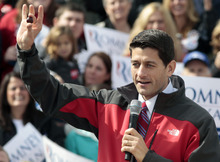 Republican vice presidential candidate, Rep. Paul Ryan, R-Wis. holds up what he said was his lucky buckeye that was given to him by Sen. Rob Portman, R-Ohio, during a campaign rally, Monday, Oct. 15, 2012,  at Lunken Airport in Cincinnati. (AP Photo/Al Behrman)